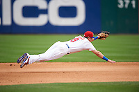 Buffalo Bisons third baseman Andy Burns (8) makes an attempt at a diving stop during a game against the Louisville Bats on June 23, 2016 at Coca-Cola Field in Buffalo, New York.  Buffalo defeated Louisville 9-6.  (Mike Janes/Four Seam Images)