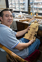 Wenzhou, Zhejiang, China.  Artist Yung Huachun with Figure of Luo Bang, Creator of Boxwood Carving, Arts and Crafts Research  Institute.
