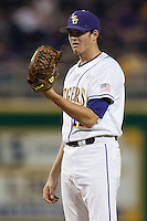 LSU Tigers starting pitcher Kevin Gausman #12 looks in for the catcher's sign against the Mississippi State Bulldogs during the NCAA baseball game on March 16, 2012 at Alex Box Stadium in Baton Rouge, Louisiana. LSU defeated Mississippi State 3-2 in 10 innings. (Andrew Woolley / Four Seam Images)