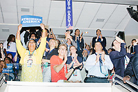 People cheer while Vice President Joe Biden speaks at the Democratic National Convention at the Wells Fargo Center in Philadelphia, Pennsylvania, on Wed., July 27, 2016.  At top right are twin brothers and politicians Joaquin and Julian Castro, and former US Representative Gabby Giffords and her husband, astronaut Mark Kelly.