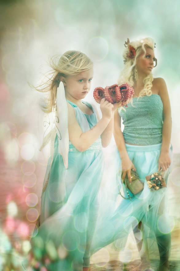 Fashion Photography by Liisa Roberts of Kailua, Hawaii.  Water Nymphs.  Child holds octopus.  Tulle dresses.. Portfolio shoot.