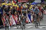 The main bunch crosses the finish line at the end of Stage 3 of the 99th edition of the Tour de France 2012, running 197km from Orchies to Boulogne-sur-Mere, France. 3rd July 2012.<br /> (Photo by Eoin Clarke/NEWSFILE)