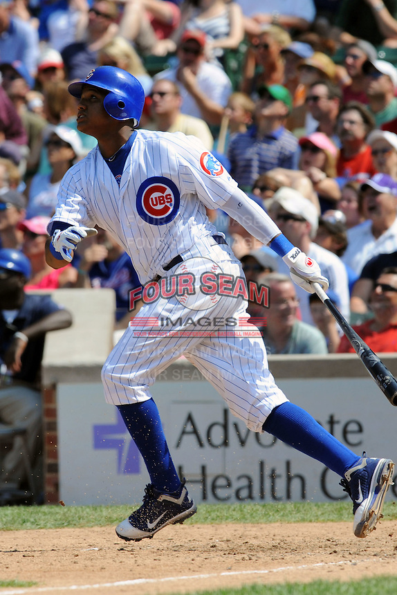 Chicago Cubs shortstop Starlin Castro #13 swings at a pitch during a game against the Arizona Diamondbacks at Wrigley Field on July 15, 2012 in Chicago, Illinois. The Cubs defeated the Diamondbacks 3-1. (Tony Farlow/Four Seam Images).