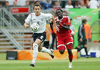 John Terry of England beats Kenwyne Jones of Trinidad to the ball. England defeated Trinidad & Tobago 2-0 in their FIFA World Cup group B match at Franken-Stadion, Nuremberg, Germany, June 15 2006.