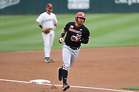 Nebraska Luke Roskam (25) runs home for a score, Monday, June 7, 2021 in the NCAA Fayetteville Regional at Baum-Walker Stadium in Fayetteville. Check out nwaonline.com/210608Daily/ for today's photo gallery. <br /> (NWA Democrat-Gazette/Charlie Kaijo)