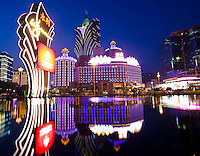 A view of the Casino Lisboa from across the fountain lake in front of the Wynn Casino in Macau. The ex-Portuguese colony of Macau in South China is a mecca for gamblers in Asia and especially China and makes more money that Las Vegas.