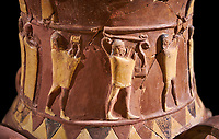 Close up of the Inandik Hittite relief decorated cult libation vase decorated with relif figures coloured in cream, red and black. The processional figures include musicians and acrobats, mid to late 16th century BC - İnandıktepe, Turkey. Against a black background