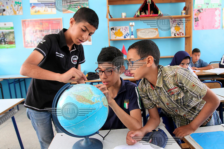 Young people studying at a centre for youths from disadvantaged backgrounds which is facilitated by local and international NGOs.