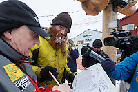 Trent Herbst signs in at the finish line in Nome on Sunday  March 22, 2015 during Iditarod 2015.  <br /> <br /> (C) Jeff Schultz/SchultzPhoto.com - ALL RIGHTS RESERVED<br />  DUPLICATION  PROHIBITED  WITHOUT  PERMISSION