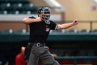 Umpire Derek Gonzales rings up a batter during a game between the Palm Beach Cardinals and Lakeland Flying Tigers on April 16, 2015 at Joker Marchant Stadium in Lakeland, Florida.  Palm Beach defeated Lakeland 6-0.  (Mike Janes/Four Seam Images)