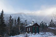 Mount Washington, Tuckerman Ravine in the White Mountains, New Hampshire USA in extreme weather conditions during the winter months. Strong winds cause snow to blow across the mountain tops.