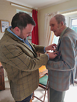 BNPS.co.uk (01202) 558833<br /> Pic: Deborah Follett/BNPS<br /> <br /> Pictured: Former Squadron Leader Ken Symonds receives the medal from Chris Loder MP<br /> <br /> <br /> An RAF veteran who flew the last Lancaster bomber home on the final sortie of the war has finally received his Bomber Command clasp 75 years later.<br /> <br /> Former Squadron Leader Ken Symonds, 97, limped his aircraft back to Britain following the last big raid of Bomber Command's Europe offensive.<br /> <br /> The sortie took place over Berchestgaden, the town in the Bavarian Alps where Adolf Hitler had his Eagles Nest retreat, on April 25, 1945 - five day's before the evil dictator's suicide.<br /> <br /> The Lancaster was struck by anti-aircraft fire which resulted in one of its four engines to be knocked out.