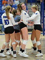 Rogers' Abby Harris (center) celebrates Tuesday, Oct. 13, 2020, with Lakyn Hawthorne (10), Madison Rhea and Kate Miller (right) after a point against Bentonville during play in King Arena in Rogers. Visit nwaonline.com/201014Daily/ for today's photo gallery. <br /> (NWA Democrat-Gazette/Andy Shupe)