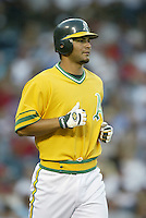 Eric Chavez of the Oakland Athletics runs the bases during a 2002 MLB season game against the Los Angeles Angels at Angel Stadium, in Anaheim, California. (Larry Goren/Four Seam Images)