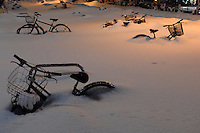 Bicycles are coverd by snow in Sapporo, Hokkaido, Japan..Feb 2008