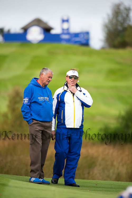 Vice Captain Miguel Angel Jimenez chats with a team member on the 6th hole during a practice session at Gleneagles Golf Course, Perthshire. Photo credit should read: Kenny Smith/Press Association Images.