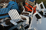 A clutter of beach chairs was left by Hurricane Irene floodwaters in the parking lot of this Avon, NC, furniture store, seen on Monday, Aug. 29, 2011.  Photo by Ted Richardson