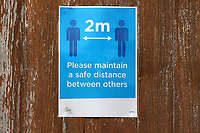 2m social distancing signage during Maldon & Tiptree vs Morecambe, Emirates FA Cup Football at the Wallace Binder Ground on 8th November 2020