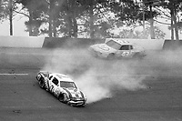 HAMPTON, GA - NOV 3:  Kyle Petty, #7 Ford, crashes as his father Richard Petty, #43 Pontiac races past during the Atlanta Journal 500 NASCAR Winston Cup race at Atlanta Motor Speedway, November 3, 1985. ((Photo by Brian Cleary/www.bcpix.com)
