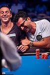Antonio Esfandiari has a laugh with Sam Trickett after winning a massive pot.