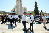 Pictured: Pallbearers carry the coffins of Theodosis Katifes and his daughter's Sevasti in Schisto, Piraeus, Greece. Friday 19 August 2016<br /> Re: The funeral for Theodosis Katifes and his five year old daughter Sevasti, two of the victims of a crash involving a speed boat and a ltourist boat has taken place at the Schisto area of Piraeus.<br /> Tharsivoulos Lykourezos, the captain of a speedboat that collided with a tourist boat off the Greek island of Aegina, killing four people, has appeared in court.<br /> The speedboat called Duente collided with a tourist boat called Antonia carrying more than 20 people.
