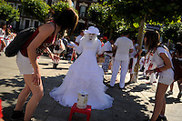 A street artist performs during the 'Chupinazo' marking the start at noon sharp of the San Fermin Festival at Castle square in Pamplona, northern Spain on July 6, 2013. Ten of thousands of people packed Pamplona's streets for a drunken kick-off to Spain's best-known fiesta: the nine-day San Fermin bull-running festival. © Pedro ARMESTRE