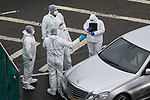 © Joel Goodman - 07973 332324 . 03/01/2017. Huddersfield, UK. Forensic scenes of crime officers at the scene of a bullet riddled silver Audi car at the slip road at Junction 24 of the M62 motorway in Huddersfield . West Yorkshire police have announced a man has died following the discharge of a police firearm , during what they describe as a pre-planned operation , yesterday evening (2nd January 2017) . Photo credit : Joel Goodman