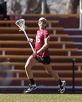 Harvard University midfielder Mariel Jenkins (16) brings the ball forward.