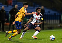 Bolton Wanderers' Peter Kioso competing with Mansfield Town's Malvind Benning (left) <br /> <br /> Photographer Andrew Kearns/CameraSport<br /> <br /> The EFL Sky Bet League Two - Bolton Wanderers v Mansfield Town - Tuesday 3rd November 2020 - University of Bolton Stadium - Bolton<br /> <br /> World Copyright © 2020 CameraSport. All rights reserved. 43 Linden Ave. Countesthorpe. Leicester. England. LE8 5PG - Tel: +44 (0) 116 277 4147 - admin@camerasport.com - www.camerasport.com