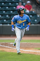 Gleyber Torres (1) of the Myrtle Beach Pelicans watches the flight of the baseball as he hustles down the first base line against the Winston-Salem Dash in game one of the Carolina League Southern Division Championship series at BB&T Ballpark on September 9, 2015 in Winston-Salem, North Carolina.  (Brian Westerholt/Four Seam Images)