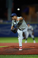 Southern Maryland Blue Crabs relief pitcher Carlos Diaz (18) delivers a pitch to the plate against the High Point Rockers at Truist Point on June 18, 2021, in High Point, North Carolina. (Brian Westerholt/Four Seam Images)