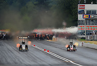 Aug. 6, 2011; Kent, WA, USA; NHRA top fuel dragster driver Tony Schumacher (left) races alongside David Grubnic during qualifying for the Northwest Nationals at Pacific Raceways. Mandatory Credit: Mark J. Rebilas-