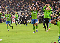LOS ANGELES, CA - OCTOBER 29: Kelvin Leerdam #18, Roman Torres #29 and Luis Silva #23 of Seattle Sounders FC celebrate their MLS Western Conference victory by defeating Los Angeles FC 3-1 during a game between Seattle Sounders FC and Los Angeles FC at Banc of California Stadium on October 29, 2019 in Los Angeles, California.