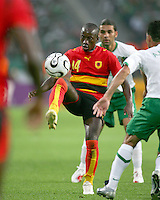 Mendonca (14) of Angola hooks the ball over his shoulder. Mexico and Angola played to a 0-0 tie in their FIFA World Cup Group D match at FIFA World Cup Stadium, Hanover, Germany, June 16, 2006.