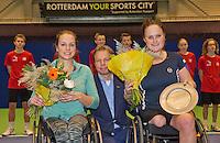 December 21, 2014, Rotterdam, Topsport Centrum, Lotto NK Tennis, Lady's wheelchair final, Winner Aniek van Koot    (R) and runner up Jiske Griffioen, in he middle KNLTB director Erik Poel <br /> Photo: Tennisimages/Henk Koster