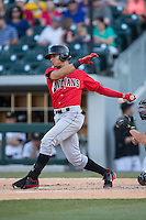 Gorkys Hernandez (7) of the Indianapolis Indians follows through on his swing against the Charlotte Knights at BB&T BallPark on June 20, 2015 in Charlotte, North Carolina.  The Knights defeated the Indians 6-5 in 12 innings.  (Brian Westerholt/Four Seam Images)
