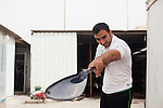 BAGHDAD, IRAQ: Saddam Hamid, a rower on Iraqi olympic rowing team, checks the straightness of his oars...Despite dangers like kidnappings, bombs, and assassinations, Iraq's olympic rowing team prepares for the London 2012 Summer Olympics...Photo by Ali Arkady/Metrography