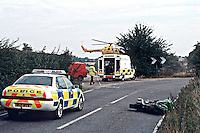 A road traffic accident involving a motorbike and a van. The driver of the van went too fast around the bend and clipped the motorbike coming the other way. The air ambulance was moblized to the rta because the motorcyclist suffered severe head injuries. The traffic police officer can be seen taking measurements for accident investigation reasons and this evidence may  well be used in court. ..© SHOUT. THIS PICTURE MUST ONLY BE USED TO ILLUSTRATE THE EMERGENCY SERVICES IN A POSITIVE MANNER. CONTACT JOHN CALLAN. Exact date unknown.john@shoutpictures.com.www.shoutpictures.com...