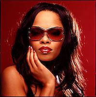 Beauty shot of African American woman wearing sunglasses