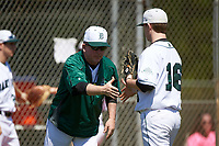 Dartmouth Big Green head coach Bob Whalen (2) shakes hands with pitcher Chris Burkholder (16) during a game against the Iowa Hawkeyes on February 27, 2016 at South Charlotte Regional Park in Punta Gorda, Florida.  Iowa defeated Dartmouth 4-1.  (Mike Janes/Four Seam Images)