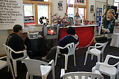 "Columbus, Ohio.USA.October 26, 2004..An independent citizen of Clombus turns a shop space into a pro-Kerry community center. It has art work against the war in Iraq and a TV viewing area where people come and freely view movies such as ""Fahrenheit 9/11"" by Michael Moore.."