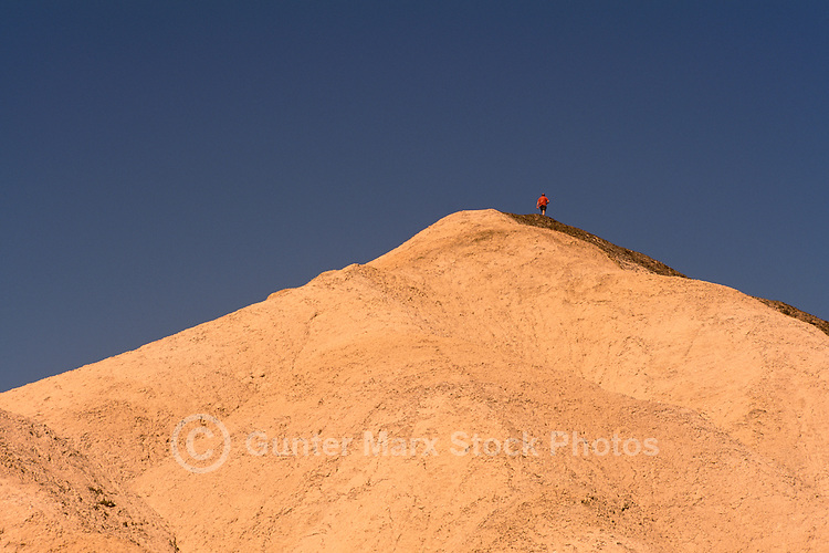 Death Valley National Park, California, CA, USA - View from Zabriskie Point of Hiker climbing Mountain Peak in the Amargosa Range
