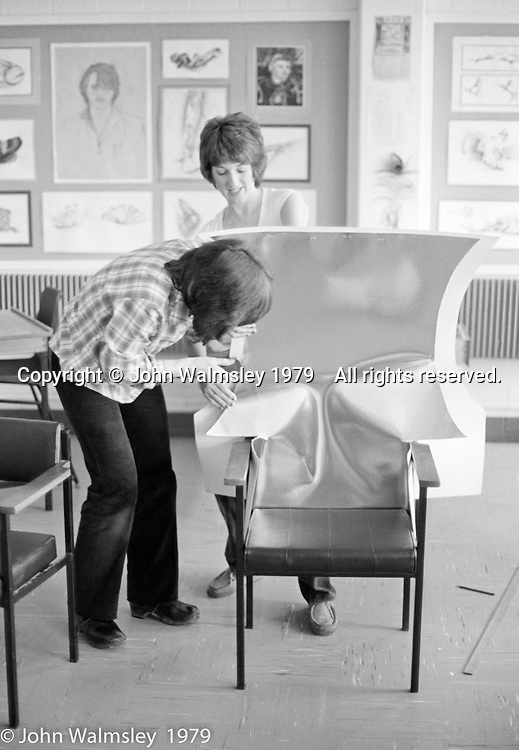 Art Dept. staff preparing the Gala Queen's throne, Wester Hailes Education Centre, Festival & Gala Day, Wester Hailes, Scotland, 1979.  John Walmsley was Photographer in Residence at the Education Centre for three weeks in 1979.  The Education Centre was, at the time, Scotland's largest purpose built community High School open all day every day for all ages from primary to adults.  The town of Wester Hailes, a few miles to the south west of Edinburgh, was built in the early 1970s mostly of blocks of flats and high rises.