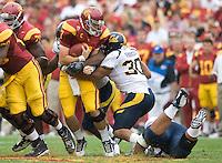Mychal Kendricks of California sacks USC quarterback Matt Barkley during the game at LA Memorial Coliseum in Los Angeles, California.  USC defeated California, 48-14.