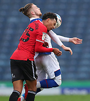7th November 2020; Ewood Park, Blackburn, Lancashire, England; English Football League Championship Football, Blackburn Rovers versus Queens Park Rangers; Niko Hamalainen of Queens Park Rangers collides with Harvey Elliott of Blackburn Rovers  as the compete for the ball in the air