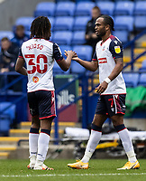 Bolton Wanderers' Nathan Delfouneso (right) celebrates with his team mate Peter Kioso after scoring his side's first goal <br /> <br /> Photographer Andrew Kearns/CameraSport<br /> <br /> The EFL Sky Bet League Two - Bolton Wanderers v Oldham Athletic - Saturday 17th October 2020 - University of Bolton Stadium - Bolton<br /> <br /> World Copyright © 2020 CameraSport. All rights reserved. 43 Linden Ave. Countesthorpe. Leicester. England. LE8 5PG - Tel: +44 (0) 116 277 4147 - admin@camerasport.com - www.camerasport.com