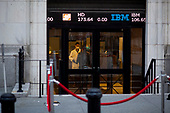 New York, New York<br /> March 18, 2020<br /> 9:14 AM<br /> <br /> Manhattan under coronavirus pandemic. <br /> <br /> New York Stock Exchange on Wall Street as traders enter the building to be met by medical workers checking people in fear of spreading the virus.