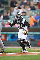 Rochester Red Wings catcher Carlos Paulino (17) chases a runner back to third during a game against the Toledo Mudhens on June 12, 2016 at Frontier Field in Rochester, New York.  Rochester defeated Toledo 9-7.  (Mike Janes/Four Seam Images)
