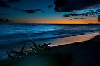 A beautiful sunset illuminating the water's edge at one of Kauai's soft-sand, south shore beaches near the town of Waimea.