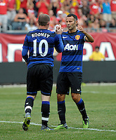 Manchester United forward Wayne Rooney (10) is congratulated by teammate Ryan Giggs (11) after scoring Manchester United's first goal.  Manchester United defeated the Chicago Fire 3-1 at Soldier Field in Chicago, IL on July 23, 2011.